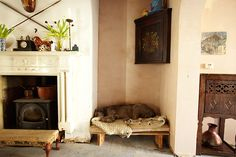 I like the idea of the cook stove in the fireplace. Think I'll do that if I ever find a nice old stove. Oh and that dog bed is nice too.