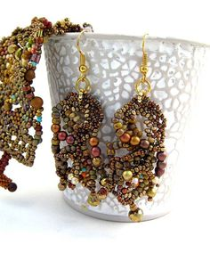 RESERVED  Rustic Seed bead earrings Brown and gold Beaded by ibics