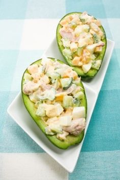 Chicken salad stuffed avocados Over-stuff'd Avocado  Ingredients:  1 medium Avocado, 3 oz. can tuna, drained, 1/4 cup each: green pepper, red onion, cucumber - all diced, 1/3 cup nonfat greek yogurt, plain, 1 tsp dijon mustard, 1 tsp lemon juice,  1/4 tsp each: sea salt, 1 packet sweetener (i.e. Splenda or stevia), 1/4 cup fresh orange sections, diced.... my mouth is watering