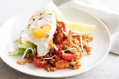 Use leftover ingredients found in the fridge to create this delicious and traditional stir-fried rice dish.