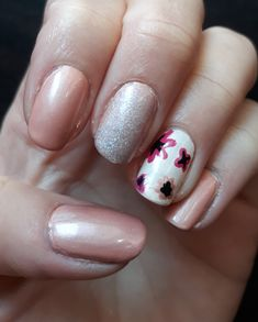 Pastel pink nails with a slight layer of holo powder and flower pattern.