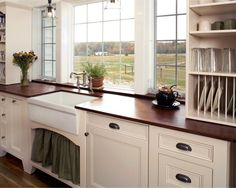 Love the cream cabinets with the dark butcher block counters!