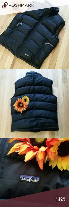 Patagonia all black puffer vest Super warm. Size medium.  Runs big for a medium in my opinion.  Two zipper pockets in front. Patagonia logo noted. Perfect transition vest. Must have. Only selling coz it's big on me now. Pls ask questions if you have any. I'm happy to help you. Pet free and smoke free closet. Patagonia Jackets & Coats Vests