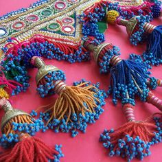 Pink background with beaded repeat motifs. Includes mirrored beads and tassels. Smaller repeat scale and has a traditional indian pattern style influence in this design. Textiles, Beaded Embroidery, Hand Embroidery, Estilo Tribal, Passementerie, Tribal Fusion, Textile Art, Needlework, Tassels