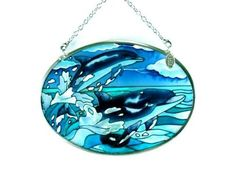 Amia 7706 Hand Painted Glass Suncatcher with Dolphin Pair Design, 3-1/4-Inch by 4-1/4-Inch Oval by Amia. $11.00. Handpainted glass; Comes boxed, makes for a great gift; Includes chain. Amia glass is a top selling line of handpainted glass decor. Known for tying in rich colors and excellent designs, Amia has a full line of handpainted glass pieces to satisfy your decor needs. Items in the line range from suncatchers, window decor panels, vases, votives and much more.