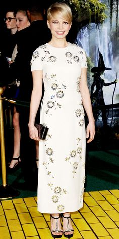 At the Hollywood premiere of Oz the Great and Powerful, Michelle Williams wowed in an embellished Prada column, sleek clutch and jeweled sandals.