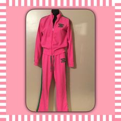 """VS """"Pink"""" lounge suit It has a couple ink spots on the back of one sleeve but to be honest I've worn it and no one noticed. Drawstring pants and zipper jacket. Stars on back of jacket and on the butt of the pants. Good condition. Pants medium and jacket small. PINK Victoria's Secret Pants Jumpsuits & Rompers"""
