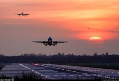 Sunrise action on Gatwick's runway with an easyJet A319 departing, closely chased by the arrival of a Cathay Pacific A350 from Hong Kong.. EGKK. Airport. JetPhotos.com is the biggest database of aviation photographs with over 3 million screened photos online!