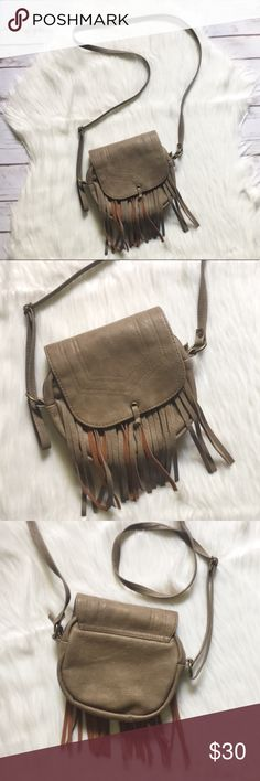 """Fringed Crossbody Bag Fringed crossbody bag. Main compartment zips closed with a top fold over that snaps closed over it. Inside, one zip side pocket, and two open pockets on opposite side. Faux leather. Approx 6"""" high, 7"""" wide, and 1.5"""" deep. Long, adjustable strap. In excellent condition. Mossimo Supply Co Bags Crossbody Bags"""