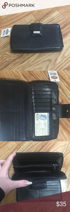 "NWT Leather Fossil wallet NWT New with tag Black soft leather Fossil wallet. 7"" w 4"" t silver Fossil name please on front snap. 12 card slots, ID window and 2 slip slots for cash, paper pics ect in snap closure compartment. 4 card slots,zipper change pocket, 1 slip slot, on zippered closure compartment. Outside has zippered change pocket large enough to fit IPhone 6+ ( in case)  up to 11/2"" deep. NEW NEVER USED but it does have some scratches in the leather and on the silver name plate for a…"