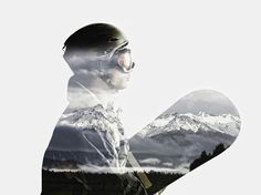 Snowboarder's silhouette in reflection of snowy mountains - Snowboarder's…