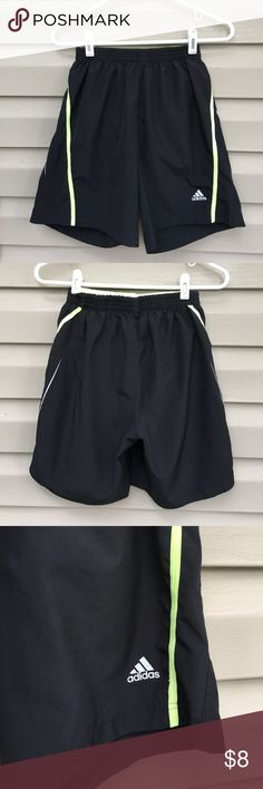 Adidas women's black running shorts Very nice black shorts with green striped sides and lining. Climalite, elastic waistband, no drawstring, polyester, no fading, stains, snags or holes Adidas Shorts