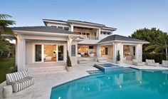 Spa-like back to Architectural Designs 5 Bed Modern Luxury House Plan 31822DN recently built in Florida. Ready when you are. Where do YOU want to build? #ModernLuxuryBedding