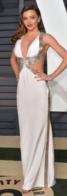 Miranda Kerr in a white cutout dress at the Vanity Fair Oscars afterparty