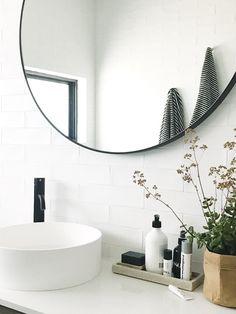 Bathroom vanity with round mirror