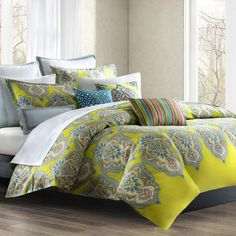 Bring alluring appeal to your guest room or master suite with this eye-catching cotton duvet cover set, featuring a regal floral print.