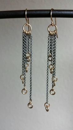 From our Fall 2017 mixed metal collection, these various length drops of gold fill circles on oxidized silver chains give an ethereal feel like stars falling out of a dark sky. Measures 3 long Thanks for your order
