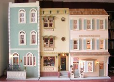 Like the way the different houses piece together. Doing that with a row of brownstones seems possible! Townhouse Row from: http://www.balazscreative.com/minipat/Townhouses.html