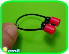 Binocular SWAP-black plastic string, black beads, red melts