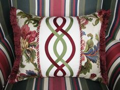 lumbar pillow was embellished with a simple Celtic applique cable design in red and green silk; Leslie Fehling design