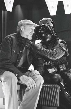 """Director Irvin Kerschner gets some loving from Darth Vader on the set of """"The Empire Strikes Back"""""""