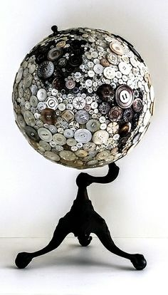 "Wow. Grab an old globe from a thrift store, simply paint the stand, then decorate with buttons or whatever else you wanted... yet another ""Why has this idea never occurred to me?!"" moment."