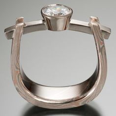 Chris Ploof: Mokume Gane Ring Curved Beam Setting, 14k red gold, 14k gray gold and very thin silver classic pattern forged into a stirrup shank with 2mm ...