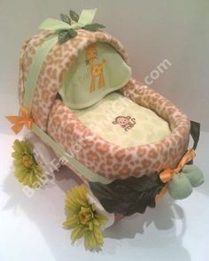 Safari Baby Carriage Diaper Cake: Our carriage diaper cakes make a great gift for a new baby or a beautiful centerpiece for baby showers.  They are served in tulle tied with beautiful premium