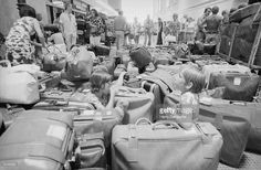 News Photo : Hundreds of suitcases await their owners at...