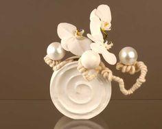 Créer une composition florale <br/>élégante pour Noël