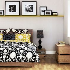 bright picture shelf across the entire wall over a low bed!