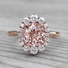 Peach Sapphire Engagement Ring with Diamond Halo (2.15ct) #DazzlingDiamondEngagementRings #engagementring #diamondengagementrings #halorings #diamondhaloring