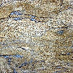 AURUS. Swirls of black and grey on a sandy gold background with hints of rust. Gorgeous granite color available at Knoxville's Stone Interiors.  Showroom located at 3900 Middlebrook Pike, Knoxville, TN.  www.knoxstoneinteriors.com  FREE Estimates available, call 865-971-5800