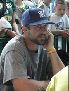 Aaron Rodgers in a crew hat, winning