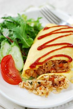 Omurice (omelette rice) recipe Instead of a ketchup omelette, make with Kimchi rice with a little siracha on top! Yum!