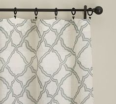 """Printed with a subtle and classic trellis motif, our sheer drape softly filters the light.50"""" wide; available in four lengths.Sold as individual panels.Woven of pure linen.Hangs from the pole pocket or converts to ring-top style with clip rings."""