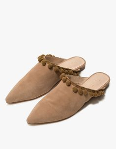 From Raye, a slip-on flat in Tan. Pointed toe. Pom pom detailing. Padded footbed. Rubber cap. • Suede upper • Leather sole • Women's sizes listed