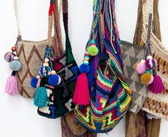 Beautiful bobbles on bright Bilum bags. These tactile treasures are a #socialenterprise product from Papua New Guinea. The bags are icons of this pacific island inextricably woven into the social and cultural fabric. They are tokens of love reminders of home holders of magic and symbols of wealth and position.  #koskela #FollowTrustDo #handmade