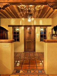 Spanish Hacienda-Style Foyer With Terra Cotta Tile
