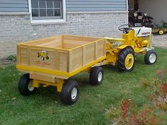 Cub Cadet 100 and a scratchbuilt wagon I built for the kids. Some neat artwork on the tailgate I always thought. Lawn Tractors, Small Tractors, Compact Tractors, Vintage Tractors, Vintage Farm, Cub Cadet Tractors, International Tractors, Tractor Implements, Car Colors