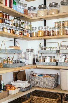 Organizing the Pantry - Love these layered metal trays. And also everything else about this pantry.