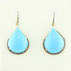 Turquoise Teardrop Earrings 14kt yellow gold 17.55ctw turquoise teardrop earrings prong set with .55ctw round brilliant diamonds on lower half and on bail.