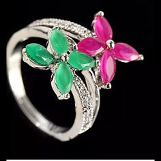 925 Sterling silver emerald & topaz ring size 8  PRICE DROP% 925 Sterling silver ring, size 8, with sparkling, green Emerald gem stones, & pink Topaz gemstones in butterfly shape, with wrap around style, flanked by AAA luster CZs. Very pretty ring. Hand made, NWOT  Jewelry Rings