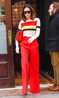 Victoria Beckham just made a case for red trousers, wearing them in New York this week. Click to see and shop her look.