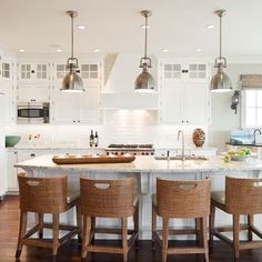 Coastal kitchen wood floors shaker style white cabinets natural textures modern nautical
