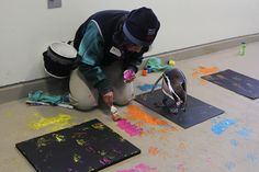 A trio of the Woodland Park Zoo's Humboldt penguins and Chai, an Asian elephant, created colorful, original paintings that will be available for purchase during the annual Holiday Silent Auction held at the zoo Friday, November 16. (Joshua Lewis / KOMO News)