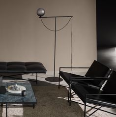 The iconic Studio Lamp series, designed by Laura Bilde, and the Globe Light series, designed by Emil Thorup, are part of the permanent lighting. Photo Lamp, Studio Lamp, Electrical Cord, Brown Interior, Brown Walls, Grey Glass, Scandinavian Living, Glass Globe, Floor Lamps