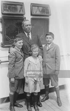 http://media.gettyimages.com/photos/the-writer-sir-arthur-conan-doyle-stands-with-his-three-children-picture-id114955148