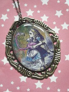 Alice and the flamingo illustrated Alice Alice in Wonderland inspired cameo pendant necklace. $8.00, via Etsy.