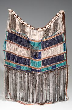 Africa | Apron from Kenya, possibly Kipsigi or Lumbwa people | Hide, cowrie shells, glass beads, metal, cord and cloth | ca. 1940s.